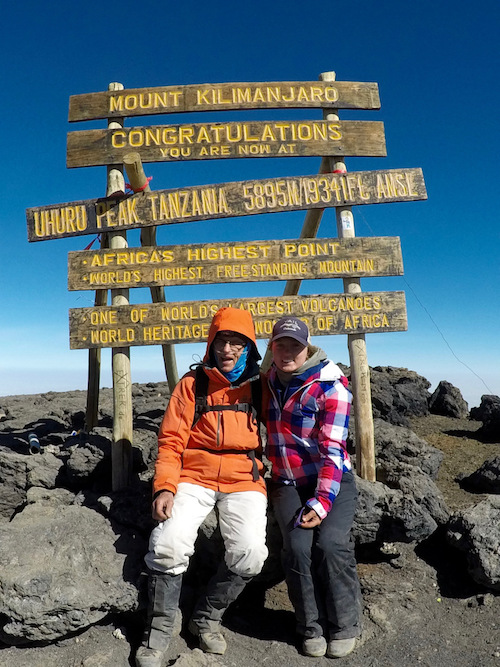 Fred Distelhorst and his granddaughter, Ellen, on the summit of Mount Kilimanjaro. © CBS